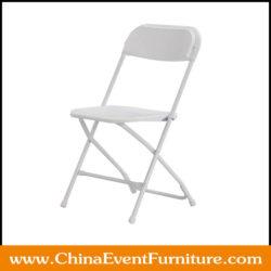 white plastic folding chair